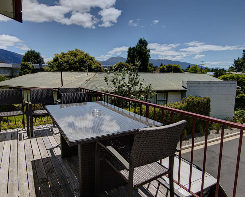 View from Red Tussock Motel's upper balcony area over the Te Anau township towards the Murchison mountains.
