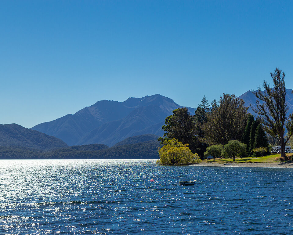View from the waters of lake Te Anau looking towards the mountains.
