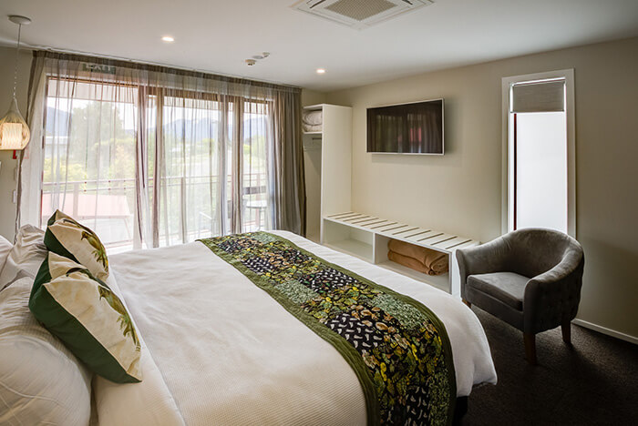 Inside Red Tussock premium studio room with super king bed